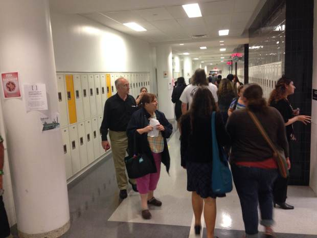 Parents shuffling from class to class.