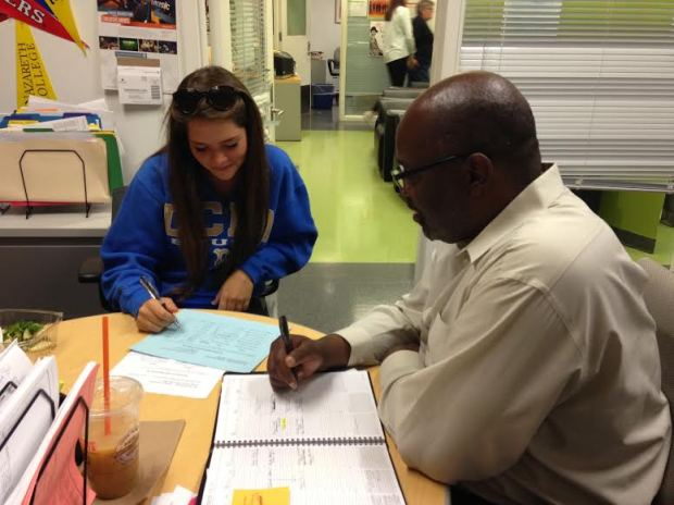 Mr. Dennis hard at work in the guidance suite with senior, Breanna Taphouse